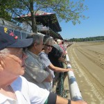 Horse Racing Fans at the Saratoga Clubhouse Rail