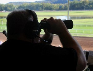 track announcer with binoculars